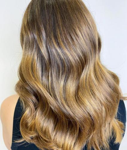 Array of caramel and honey tones, with nourished curls.