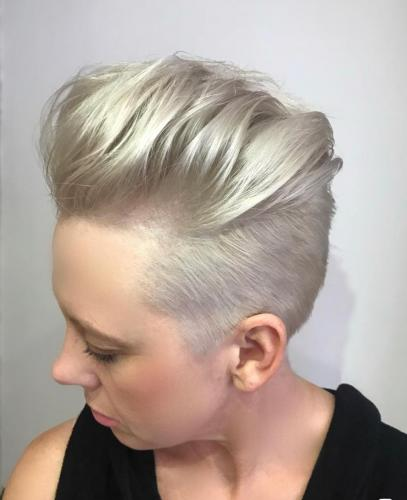Under cut accentuated with a quiff by Mark accompanied with a vibrant sheer colour by Charlie.