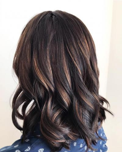 Cut and colour come together to create this warm brown with subtle highlights.